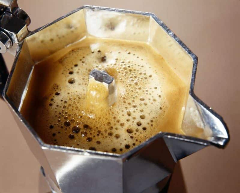 Close up of moka pot brewing coffee