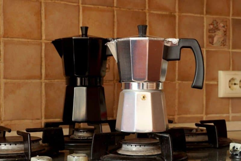 2 italian stovetop espresso makers on gas cooktop