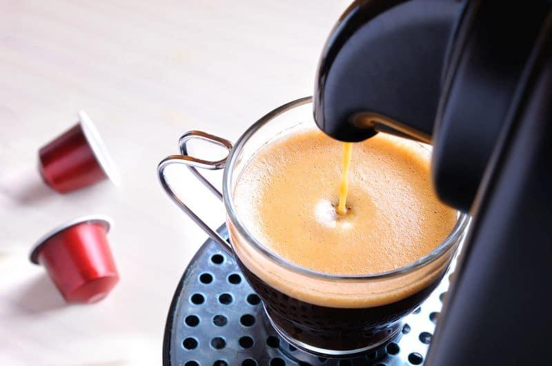 capsule machine serving espresso coffee top view