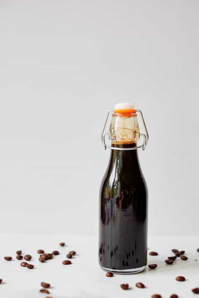 homemade coffee flavored syrup in bottle