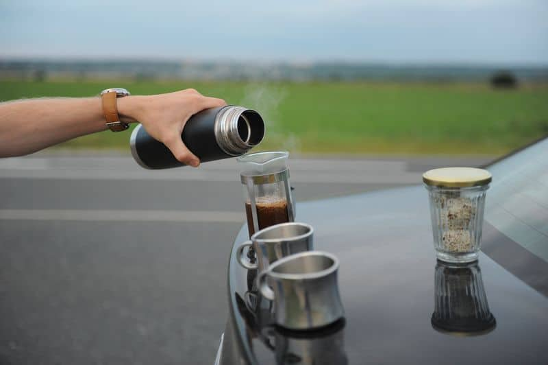 Travel Coffee Press on boot of car