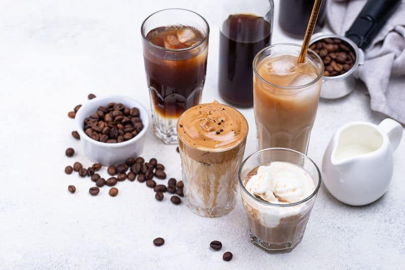 different kinds of iced coffee drinks on table