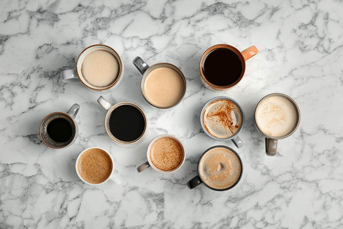 different types of coffee drinks on table