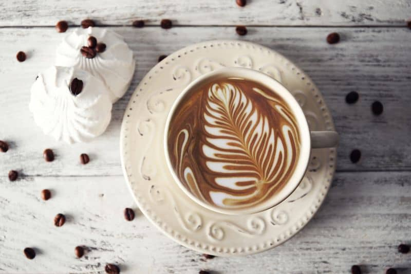 Flat white coffee drink in white ceramic cup