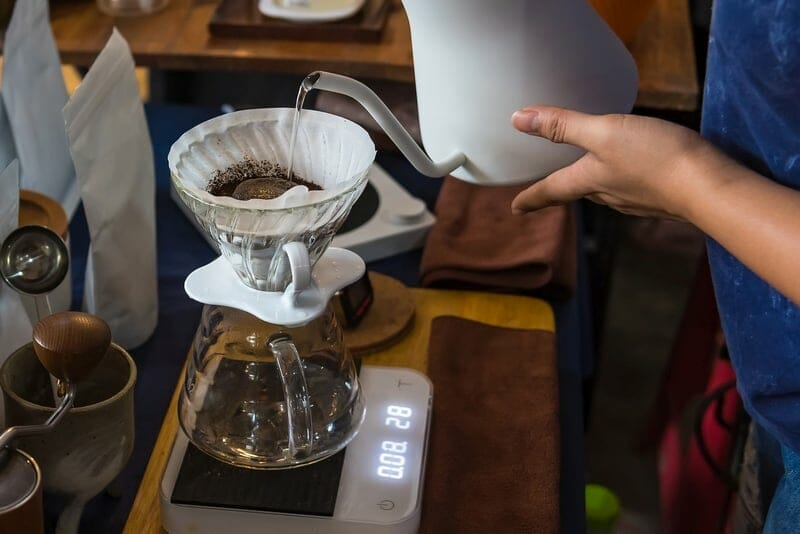 Close up of filter coffee maker, kettle with thermometer and digital scale. Brewing coffee, method pour over, drip coffee.