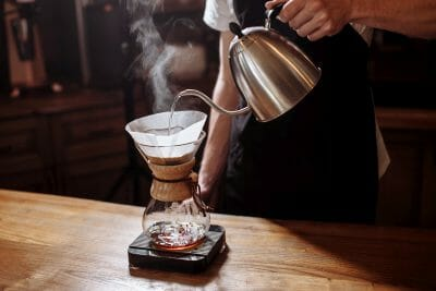 using a chemex pour over coffee maker and gooseneck kettle.